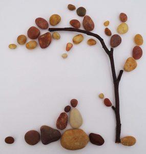 رسم شجرة بالحجارة
